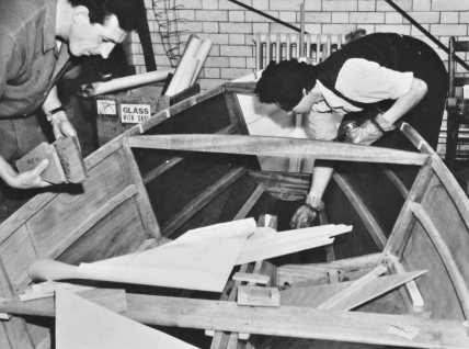 Two enthusiasts building a boat at Kentish Town Working Men's Institute, 1950s. Source: Collage.