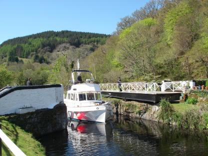 Lock opens for a motor cruiser on the Crinan Canal