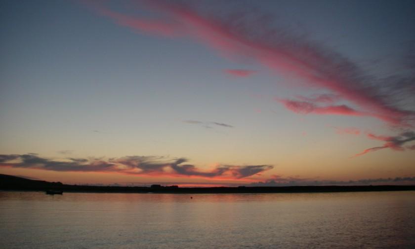 The sun sets over Blacksod Bay.