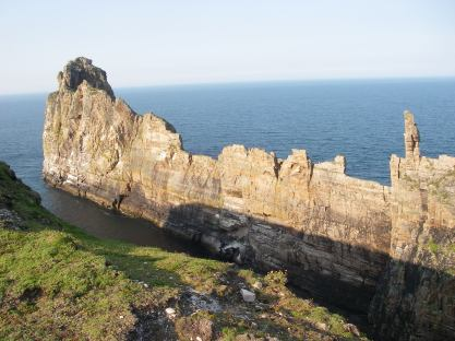 The saw-tooth cliff leading out to sea from the last redoubt of the Iron age fortress.