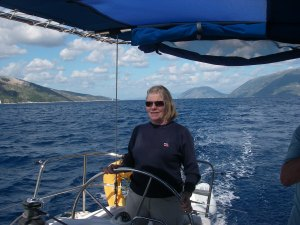 Chris at the helm in Turkish waters, where we found very large chart errors.