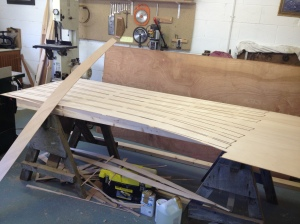Cutting planks from a plywood sheet.