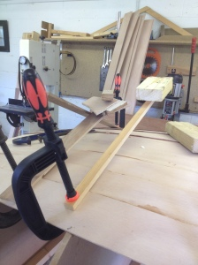Clamp, wooden lever and weight to move the pressure over the glued joint.