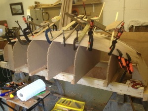Planking under way, using clamps while the glue dries