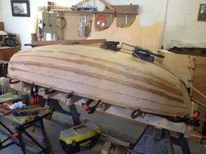 All planks glued, rubbing strips and first stage of keel glued, clamped and drying.