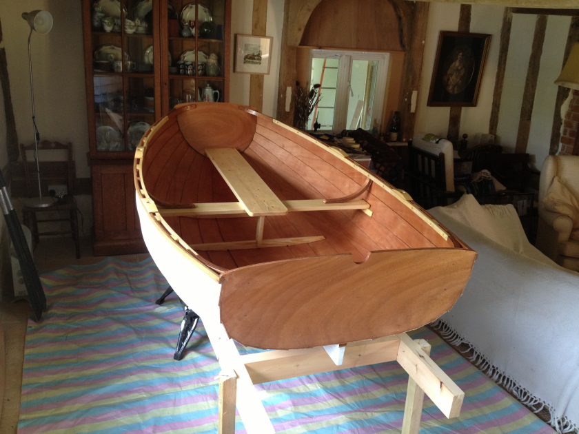 The finished boat, primed inside and out and moved from the workshop into the house for the final coats of paint and varnish