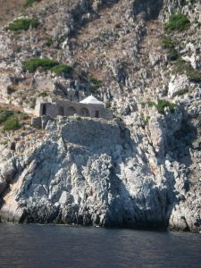 A monastery perched near the point of the cape.