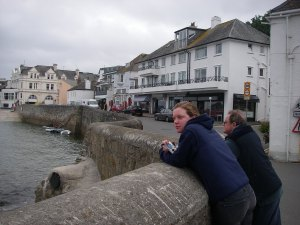 Georgi and Tony contemplate the bad weather on the  harbourside at St Mawes