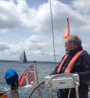 Falmouth - looking over the shoulder at a giant J-Class yacht, racing against its peers in the bay.
